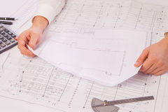 Close-up of Male hand holding Blueprint Stock Photography