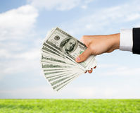 Close up of male hand holding dollar cash money Royalty Free Stock Photos