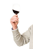 Close up on male hand holding a glass of wine Stock Photo