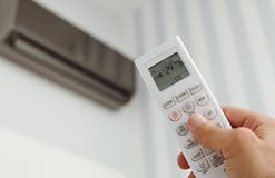 Close up of male hand adjusting the air conditioning stock image