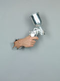 Male hand holding a spray gun Stock Photos