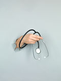 Male hand holding stethoscope Royalty Free Stock Photos