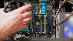 Close-up of male hand installing new CPU fun on PC
