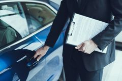 Close-up Of Male Hand Opening Blue Cars Door stock photos