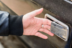 Close up of male hand opening old wooden door Royalty Free Stock Photography