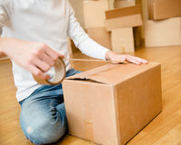 Close up of male hand packing cardboard box Royalty Free Stock Image