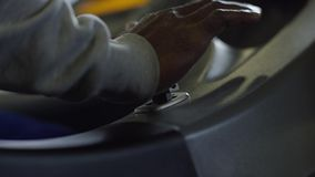 Close-up of male hand pushing on the lever of some mechanical or electrical device. Stock footage. Science and stock video footage