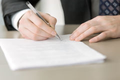 Close up of male hand putting signature Royalty Free Stock Image