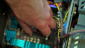 Close-up of male hand removes CPU and shows it.
