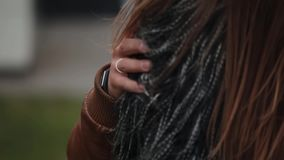 Close-up of a male hand with a ring moving on his lovers fur coat. Lovers stand together. stock video footage