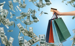 Close up of male hand shopping bags and bank card Stock Photography