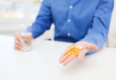 Close up of male hand showing lot of pills Royalty Free Stock Image