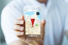 Close up of male hand showing map on smartphone Royalty Free Stock Image