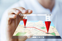 Close up of male hand showing smartphone and map. Business, technology, navigation, location and people concept - close up of male hand holding and showing Royalty Free Stock Images
