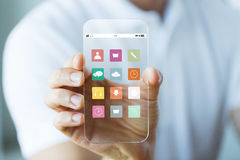 Close up of male hand showing smartphone menu Royalty Free Stock Images