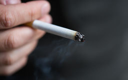 Close up of male hand with smoking cigarette Stock Photos