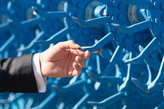 Close up of male hand touching blue cultivator royalty free stock photography