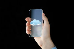 Close up of male hand with transparent smartphone. Business, future technology, computing and people concept - close up of male hand holding and showing Stock Photography