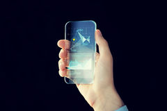 Close up of male hand with transparent smartphone Royalty Free Stock Photo