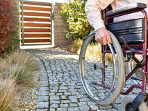 Close-up of male hand on wheel of wheelchair Stock Photography