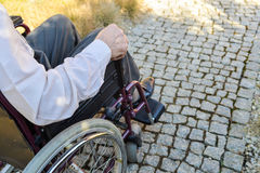 Close-up of male hand on wheel of wheelchair stock photos