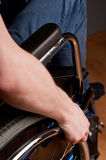 Close-up of male hand on wheel of wheelchair Royalty Free Stock Photos