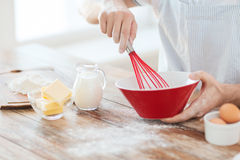 Close up of male hand whisking something in a bowl. Cooking and home concept - close up of male hand whisking something in a bowl Stock Photos