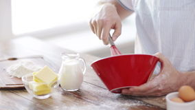 Close up of male hand whisking something in a bowl stock video footage