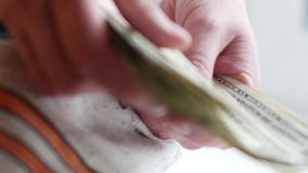 Close-up of male hands counting dollar bills. UltraHD video. Close-up of male hands counting dollar bills. 4K UltraHD video stock footage
