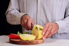 Close up on male hands cutting pepper, making salad. Chief cutting vegetables. Healthy lifestyle, diet food Royalty Free Stock Photography