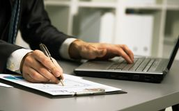 Close up of male hands doing paperwork Royalty Free Stock Photography