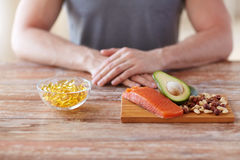 Close up of male hands with food rich in protein Stock Photos