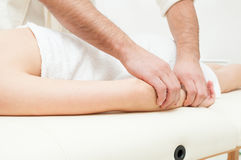Close-up of male hands getting a woman forearm massage Royalty Free Stock Images