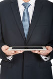 Close up on male hands holding digital tablet Royalty Free Stock Image