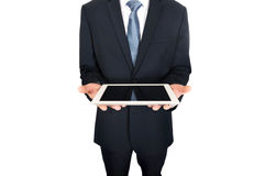 Close up on male hands holding digital tablet Stock Photo