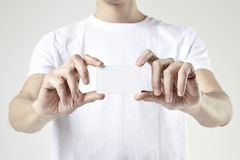 CLose-up male hands holding showing plastic card. Blank space for design layout. CLose-up male hands holding showing plastic card. Blank space for design layout royalty free stock photography
