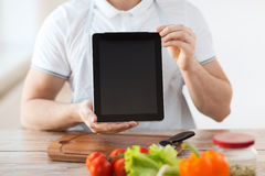 Close up of male hands holding tablet pc Royalty Free Stock Photo