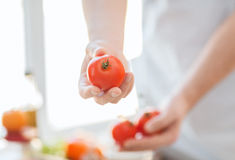 Close up of male hands holding tomatoes Stock Image