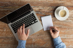 Close up of male hands with laptop and notebook Stock Photos