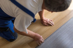 Close up of male hands lying parquet floor board stock photos