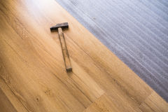 Close up of male hands lying parquet floor board stock photo
