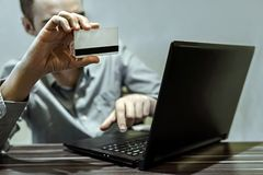 Close up of hands making online payment stock image