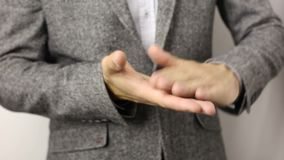 Close-up on male hands making throwing money gesture. Concept of wealth, richness and wasting dough. Bill tossing. Solid caucasian man in gray jacket and stock video