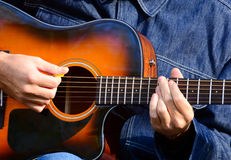 Close up of male hands playing guitar Royalty Free Stock Image