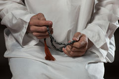 Close-Up Of Male Hands Praying With Rosary Stock Images
