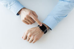 Close up of male hands setting smart watch Stock Images