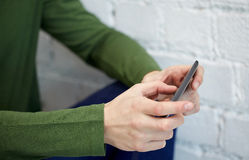 Close up of male hands with smartphone. People, technology and internet concept - close up of male hands with smartphone at school Royalty Free Stock Photography
