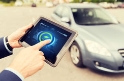 Close up of male hands with tablet pc and car Stock Photos