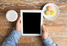 Close up of male hands with tablet pc and coffee Royalty Free Stock Photography