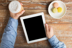 Close up of male hands with tablet pc and coffee Stock Photography
